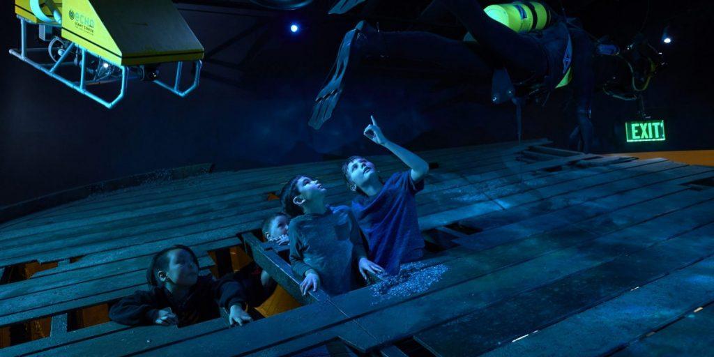 Kids exploring shipwreck exhibit