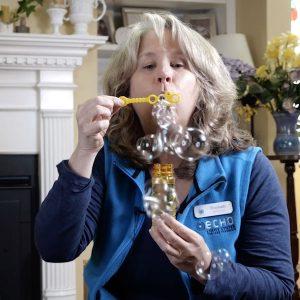 Elizabeth blowing bubbles