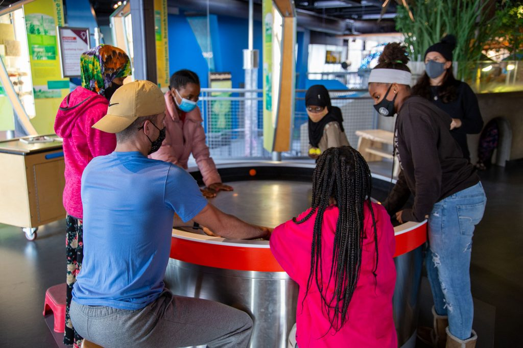 Kids and adults test out the spinning table