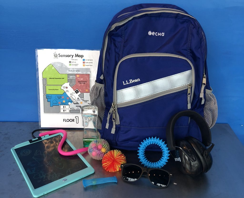 ECHO's sensory backpack. The one shown here is blue in front of a blue background. It also shows sensory map, sensory tools, writing pad, noise-cancelling headphones